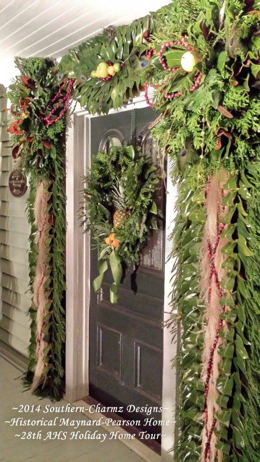 Angled view of the front door Christmas Designs showcasing fresh fruits and evergreens. Christmas is coming...!