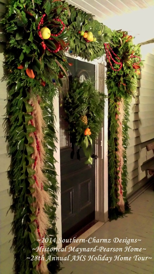 Angled view of the front door Christmas Designs showcasing fresh fruits and evergreens. Christmas is definitely on its way...!