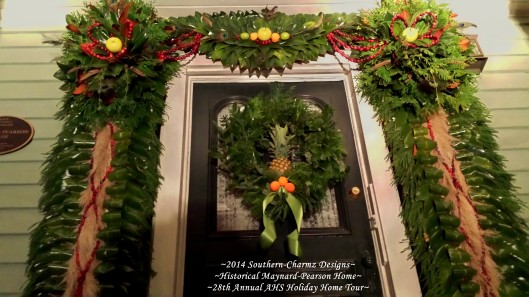 Front Door Post-Bellum/Pre-Victorian Christmas Designs by Southern-Charmz Interiors. What a delightful fresh evergreen display of Cedar, Magnolia, Frasier fir, Pampass plumes, fruits and feathers.