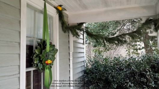 Southern-Charmz Designs for the front porch this year include fresh cedar and white pine porch swags with a lemon accent along with a fresh magnolia leaf wreath with fresh fruit accents of green apple, cranberries and fresh orange-peel roses. Don't you just want to sit with a nice cup of hot chocolate on this porch?