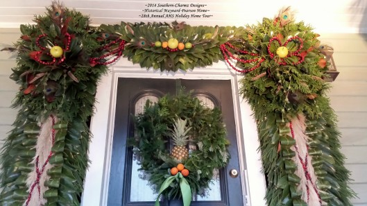 Front Door Post-Bellum/Pre-Victorian Christmas Designs by Southern-Charmz Interiors. What a delightful fresh evergreen display of Cedar, Magnolia, Frasier fir, Conifer, Pampass plumes, fruits and feathers. The side supports feature a new technique of ribbon-folding of magnolia leaves which offer another texture to a Southern Christmas Staple...the Magnolia Leaf. This anchoring technique over rows of conifer and cedar allows a showcasing center portion to display a bed of billowing pampass plumes and criss-crossing strands of freshly strung cranberries.